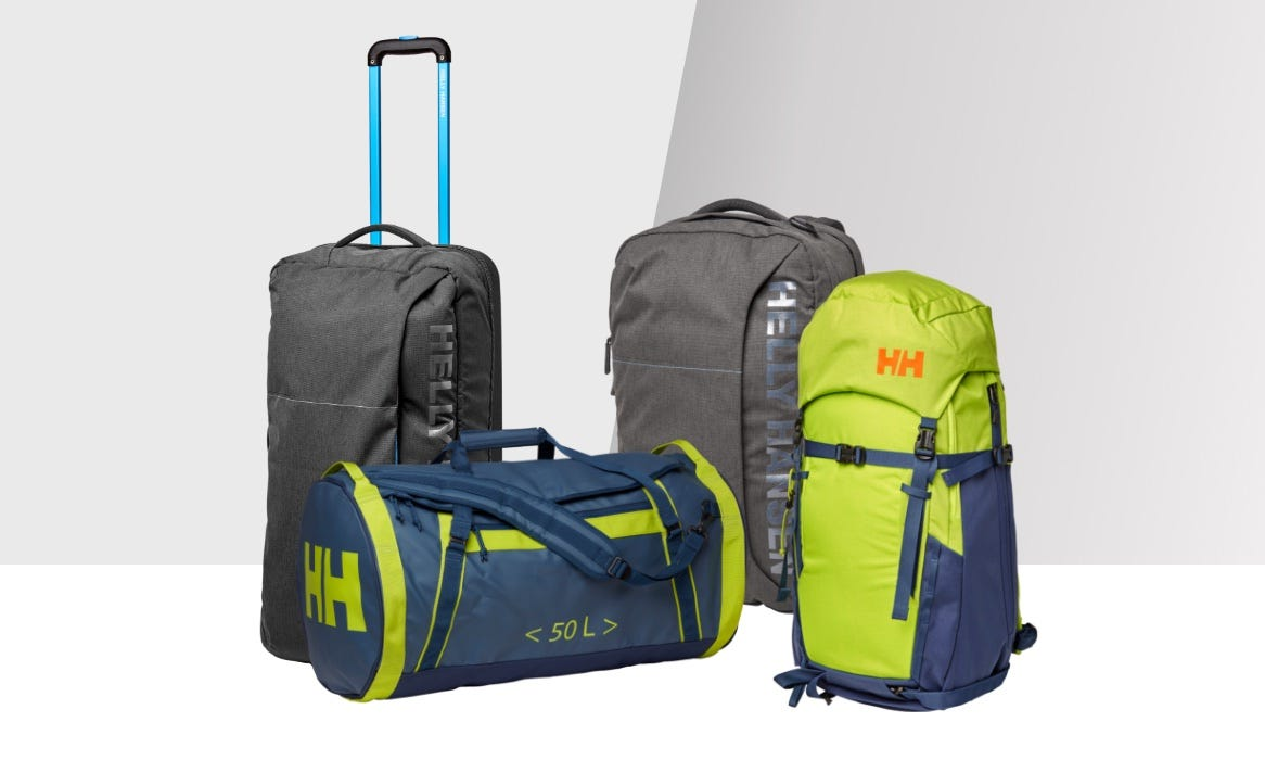 A variety of HH bags and backpcks displayed on a plain backdrop