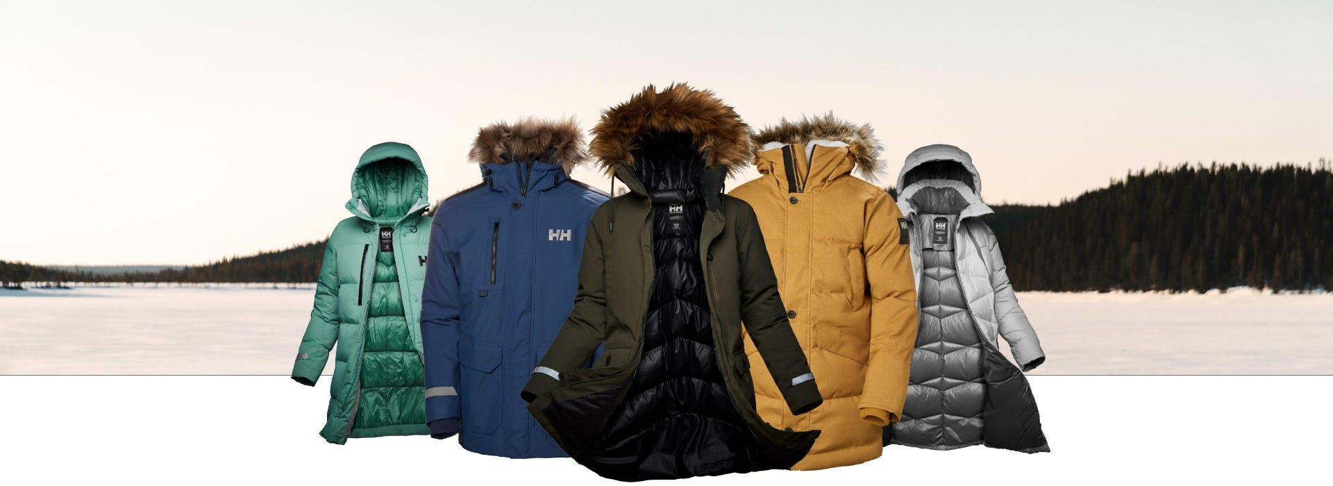 A variety of parkas displayed on a winter outdoor backdrop