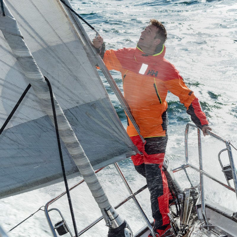 Man on boat sailing in HH coastal cruising gear