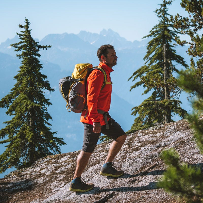 Man hiking outdoors wearing a Helly Hansen midlayer