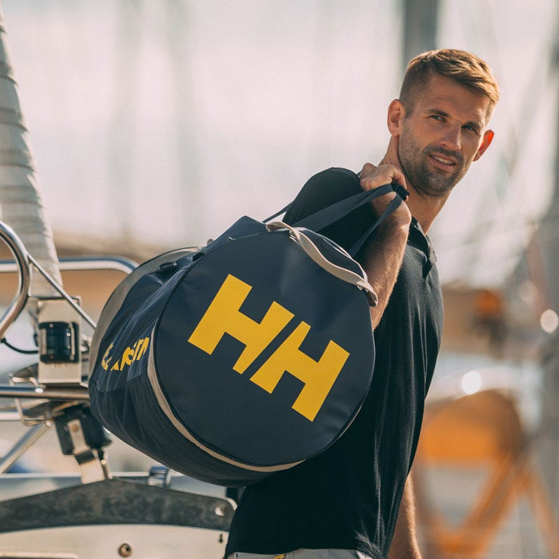 Man carrying HH sailing bag
