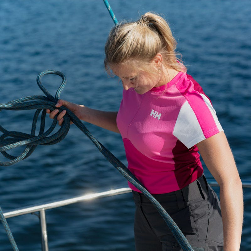 Woman wearing a sailing base layer on boat