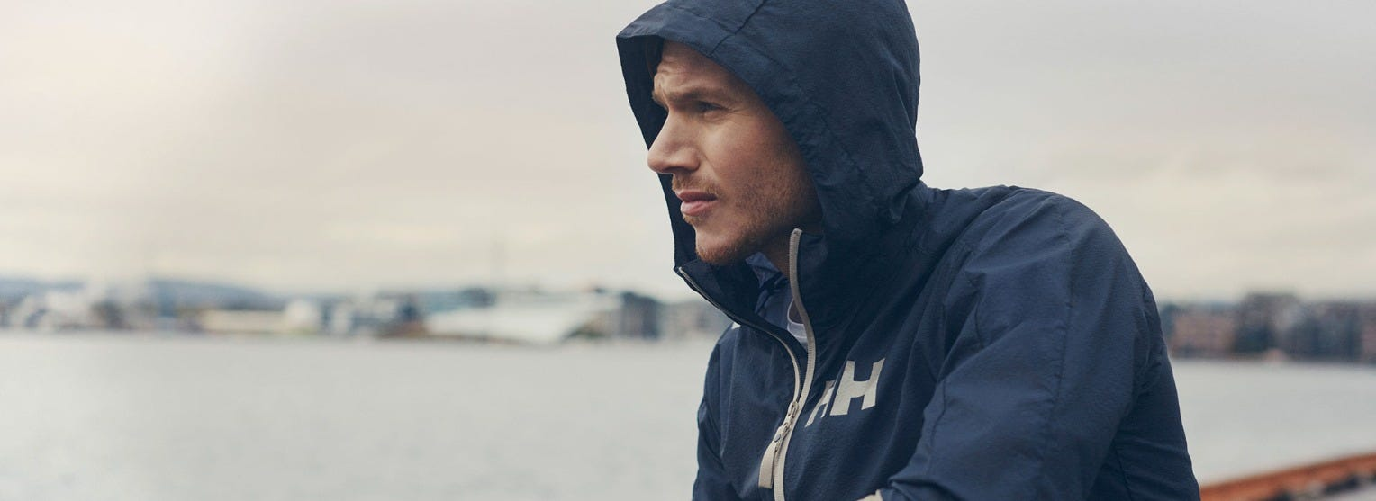 Man in Active Windbreaker Jacket by Oslo Fjord.