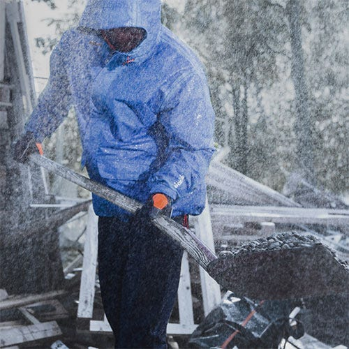 Man on construction site in rain