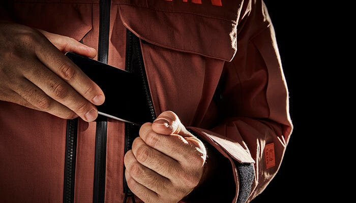 The Life Pocket™ is integrated into the chest pocket to make the phone accessible in a second