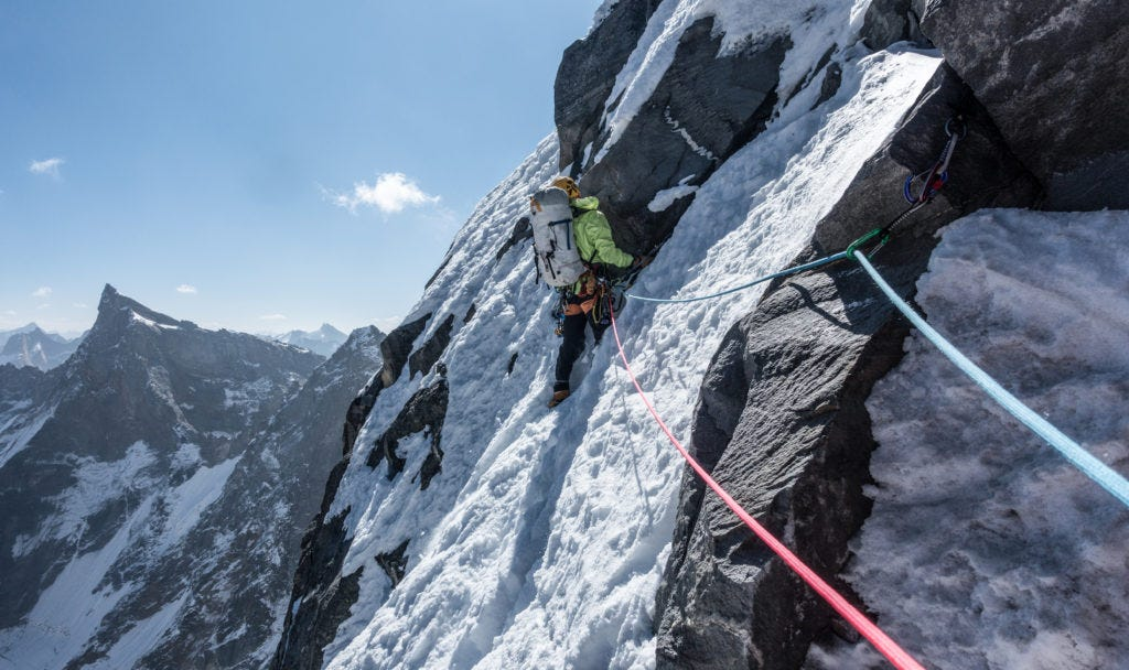 Alan leading a pitch half way up the north ridge using rock gear on route