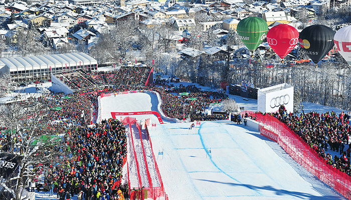 Crowd cheering at the finish line of the Streif