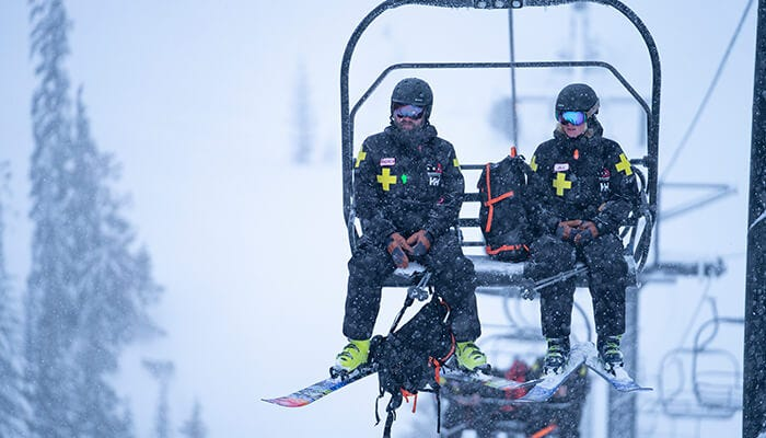 Motivated professional ski patrollers on the mountain