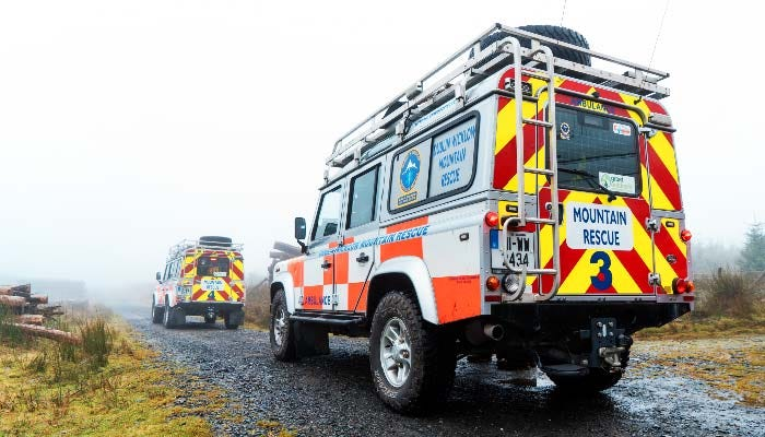 DWMRT rescue trucks on a gravel road