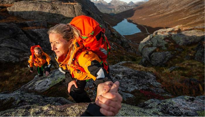 Volunteers of the Norwegian People's Aid hiking through the mountains