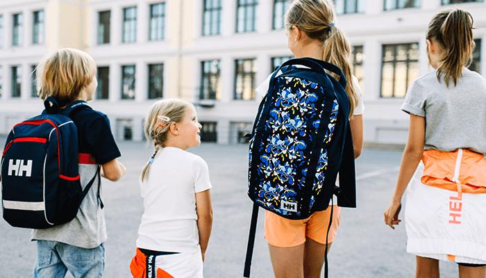 kids walking around with backpacks