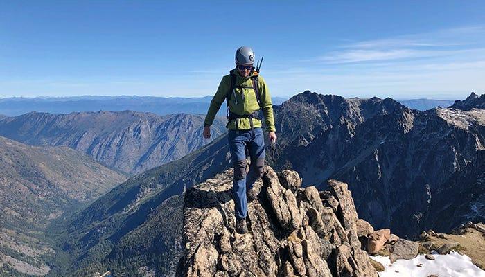 Man on the peak of a mountain.