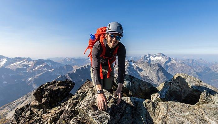 mountaineer summits mountain.