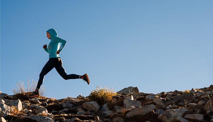 trail runner strides across terrain.