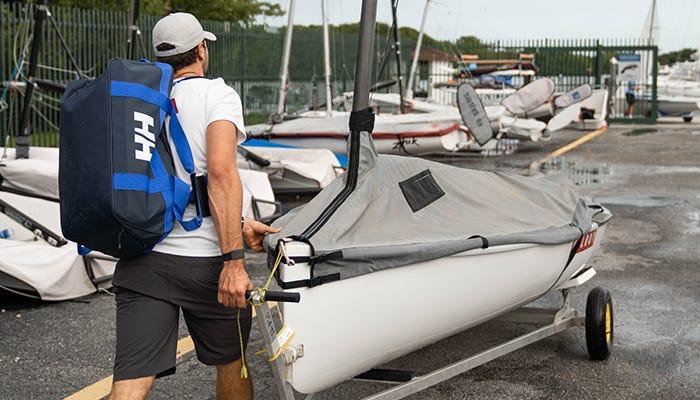 sailor preps boat.