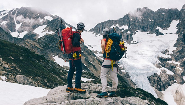 mountaineers stare at mountains
