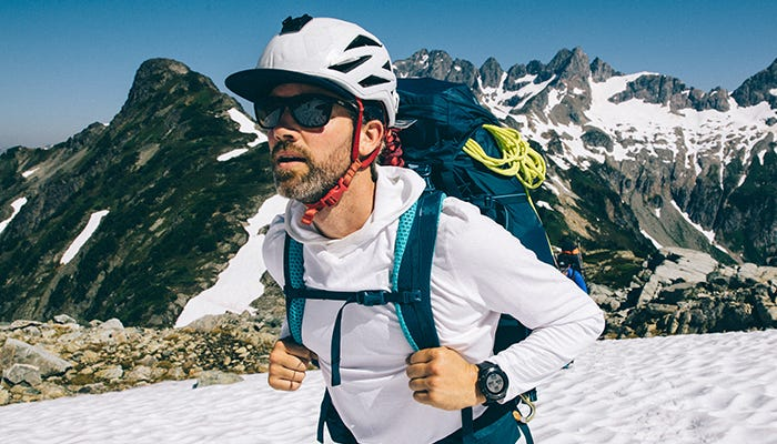 Mountaineer in front of mountain ridgeline.