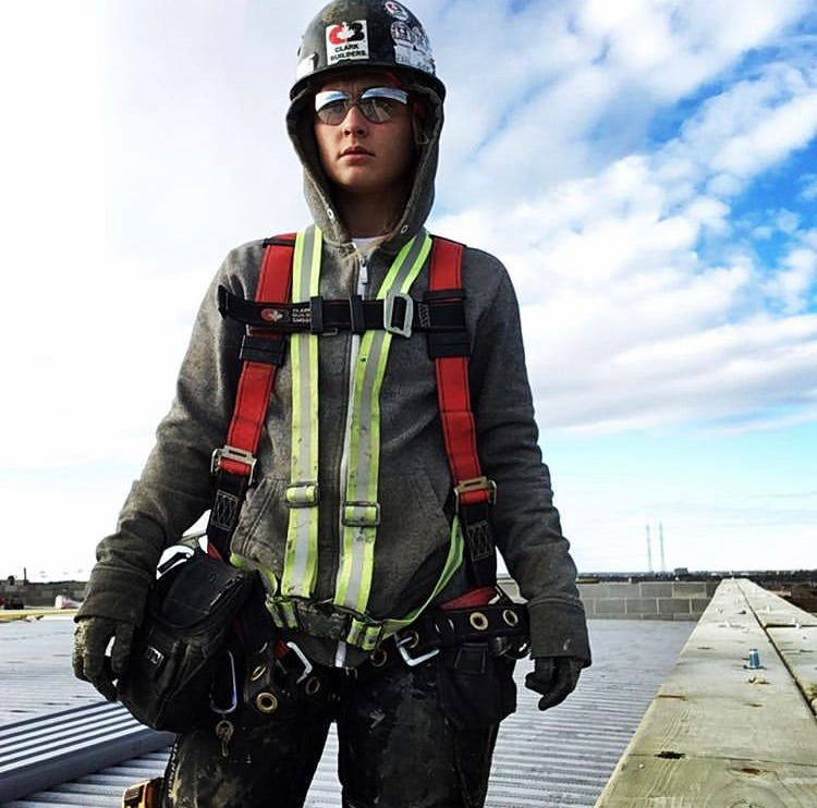 Woman standing at construction site.
