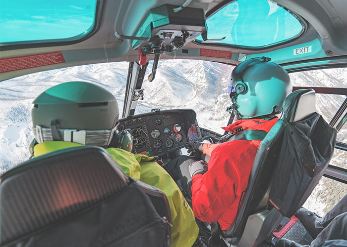 A perspective of inside the cockpit of the helicopter.