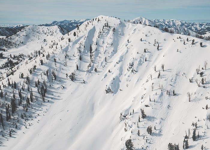Landscape image of a snowy mountain ridge.