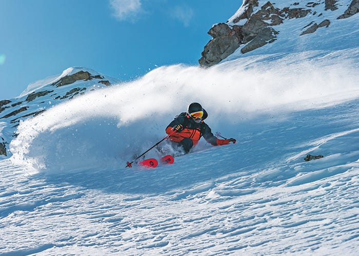 Skier turns, coming down the mountain.