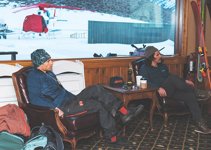 Jim Ryan and Marcus Caston sit in the heli guide office.