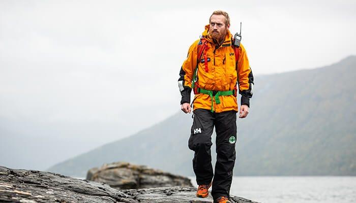 man hiking in rescue gear